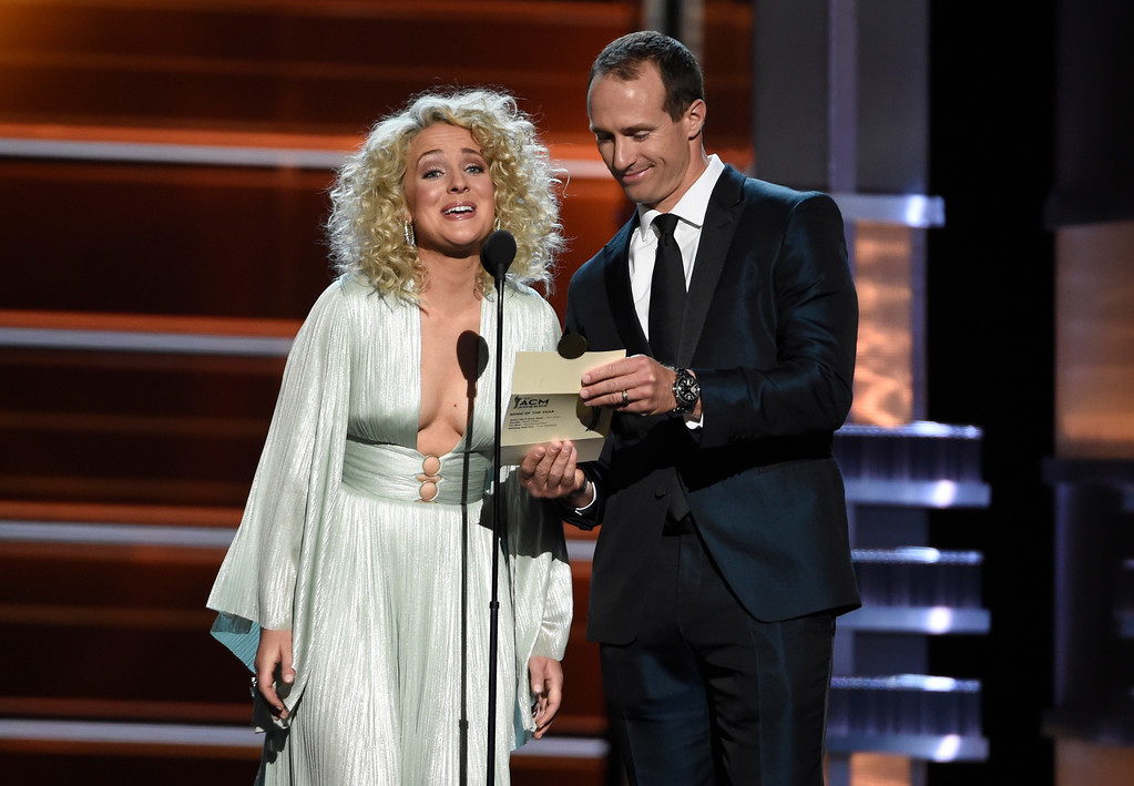 . Cam, left, and Drew Brees present the award for song of the year at the 53rd annual Academy of Country Music Awards at the MGM Grand Garden Arena on Sunday, April 15, 2018, in Las Vegas. (Photo by Chris Pizzello/Invision/AP)
