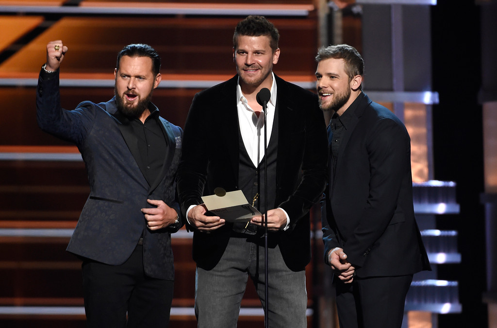 . A.J. Buckley, from left, David Boreanaz, and Max Thieriot present the award for vocal group of the year at the 53rd annual Academy of Country Music Awards at the MGM Grand Garden Arena on Sunday, April 15, 2018, in Las Vegas. (Photo by Chris Pizzello/Invision/AP)