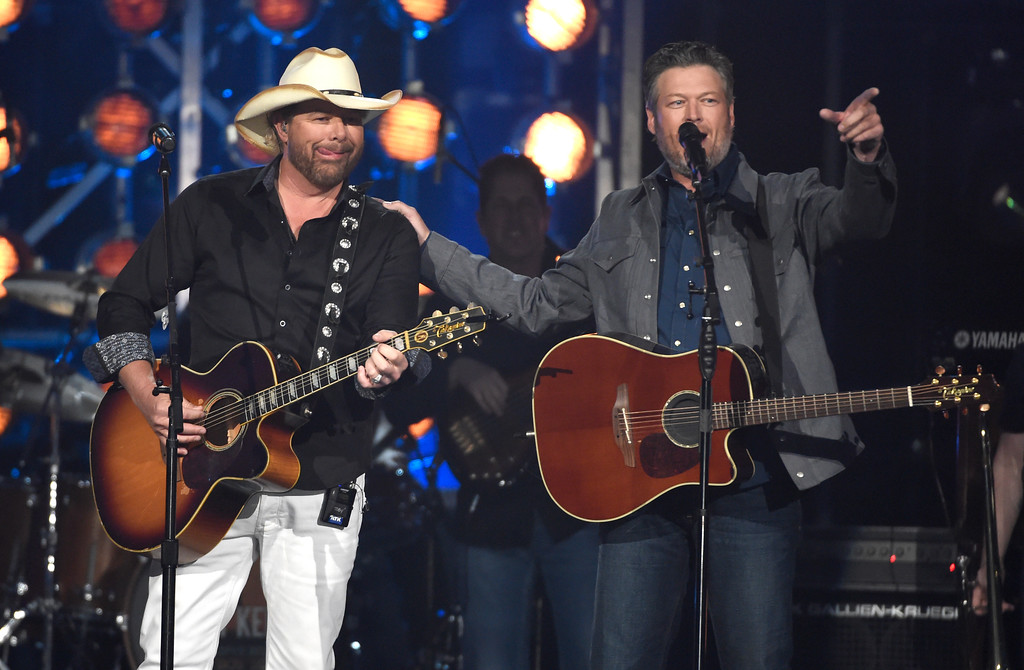 ". Toby Keith, left, and Blake Shelton perform ""Should\'ve Been a Cowboy\"" at the 53rd annual Academy of Country Music Awards at the MGM Grand Garden Arena on Sunday, April 15, 2018, in Las Vegas. (Photo by Chris Pizzello/Invision/AP)"