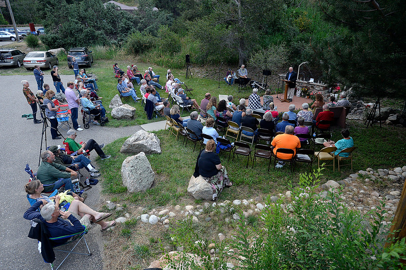 People gather for the 41st Big Thompson Flood Memorial Monday, July 31, 2017 in Drake west of Loveland.  (Photo by Jenny Sparks/Loveland Reporter-Herald)