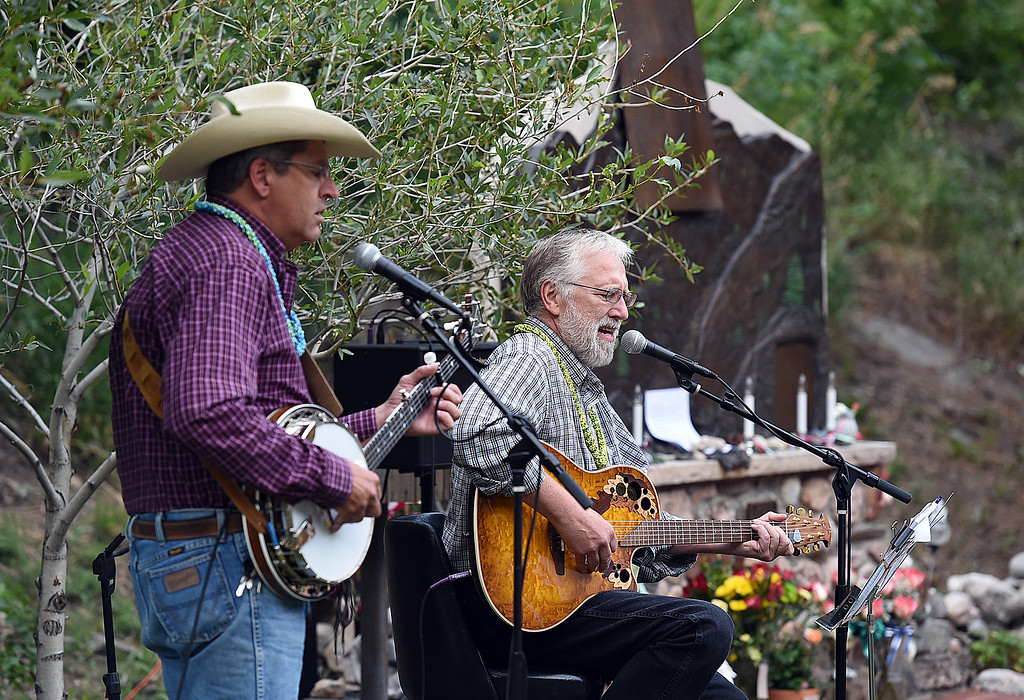 . Flood survivor Jerry Shaffer,center, sings during the 41st Big Thompson Flood Memorial Monday, July 31, 2017 in Drake west of Loveland.  (Photo by Jenny Sparks/Loveland Reporter-Herald)