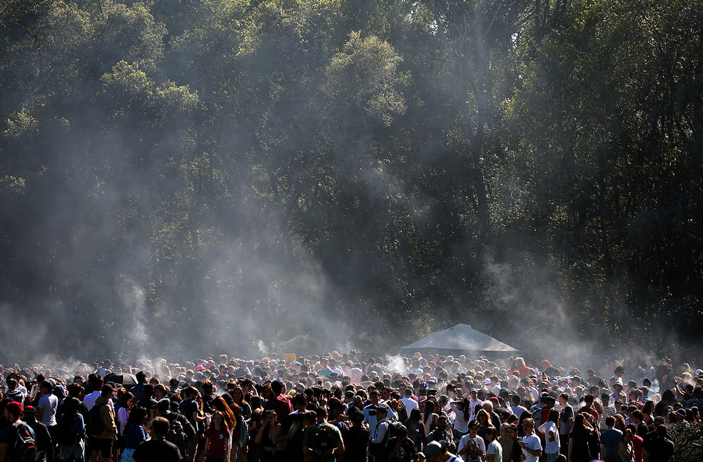 . Porter Meadow is filled with students taking part in the annual 420 revelry at UC Santa Cruz Thursday afternoon. (Shmuel Thaler � Santa Cruz Sentinel)