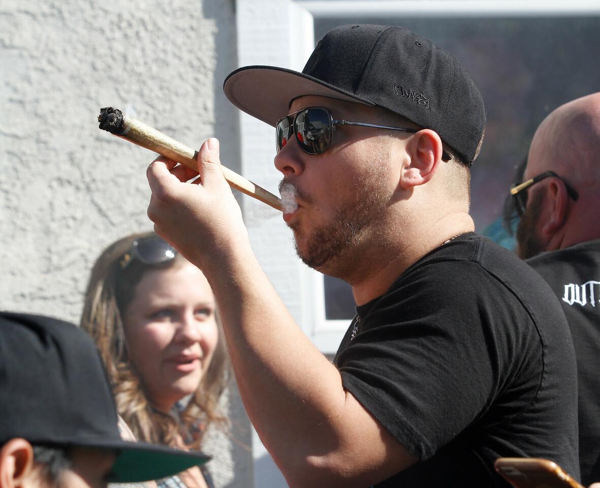People celebrate 420 Thursday April 20, 2017 at Blaze N' J's Smoke Shop in Chico, California. (Emily Bertolino -- Enterprise-Record)