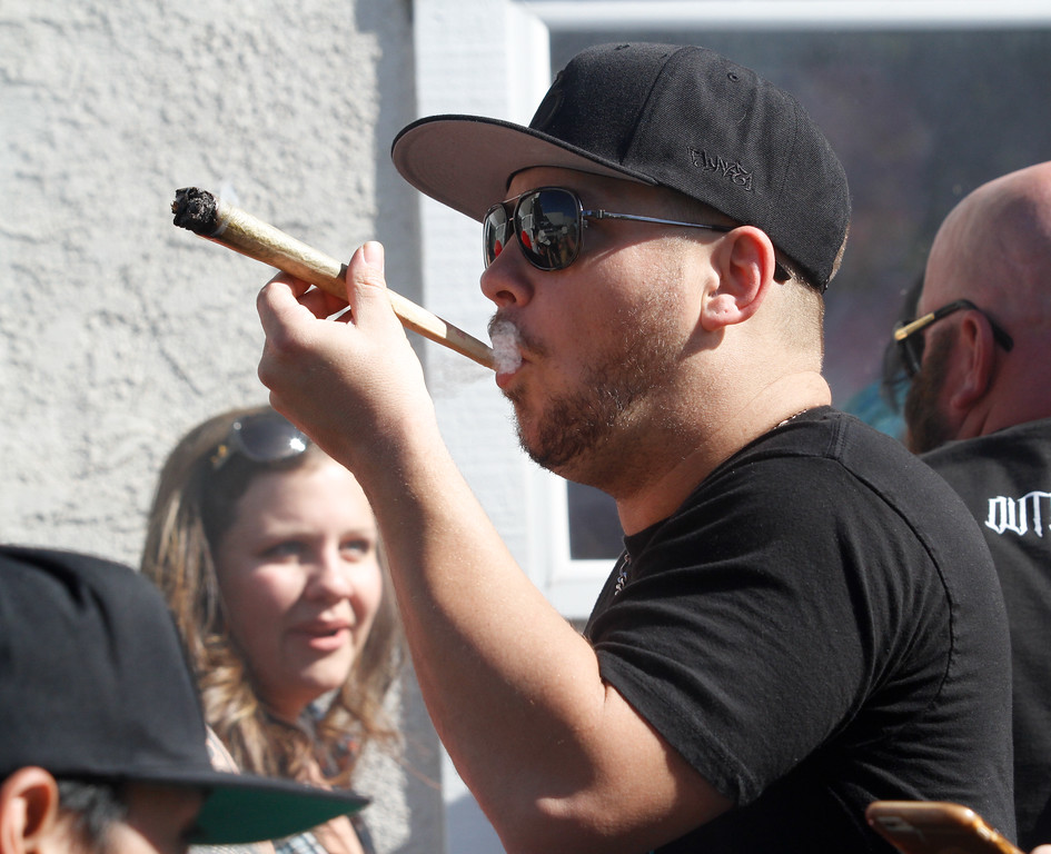 . People celebrate 420 Thursday April 20, 2017 at Blaze N\' J\'s Smoke Shop in Chico, California. (Emily Bertolino -- Enterprise-Record)