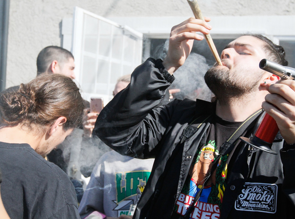 ". Nick \""Smokiee\"" Alvarez takes a puff from a huge joint at 4:20 p.m. Thursday April 20, 2017 at Blaze N\' J\'s Smoke Shop in Chico, California. (Emily Bertolino -- Enterprise-Record)"