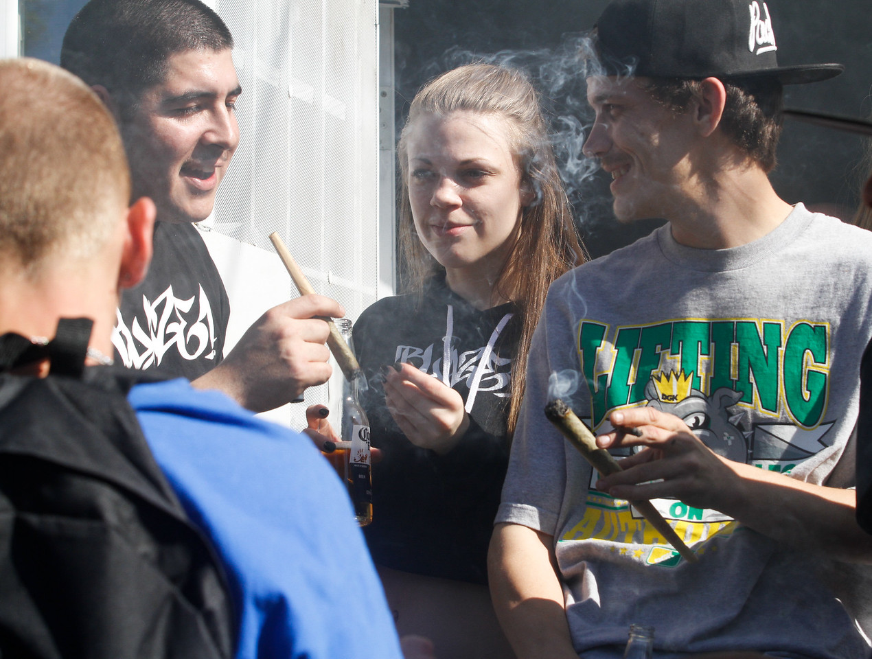 Huge joints are passed around during a 420 party Thursday April 20, 2017 at Blaze N' J's Smoke Shop in Chico, California. (Emily Bertolino -- Enterprise-Record)