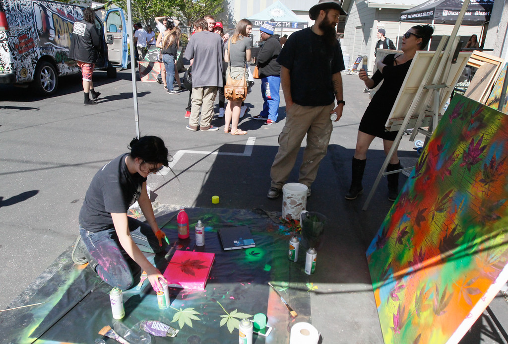 . Tasha Begley uses pot leaves as stencils during a 420 party at Blaze N\' J\'s Smoke Shop Thursday April 20, 2017 in Chico, California. (Emily Bertolino -- Enterprise-Record)