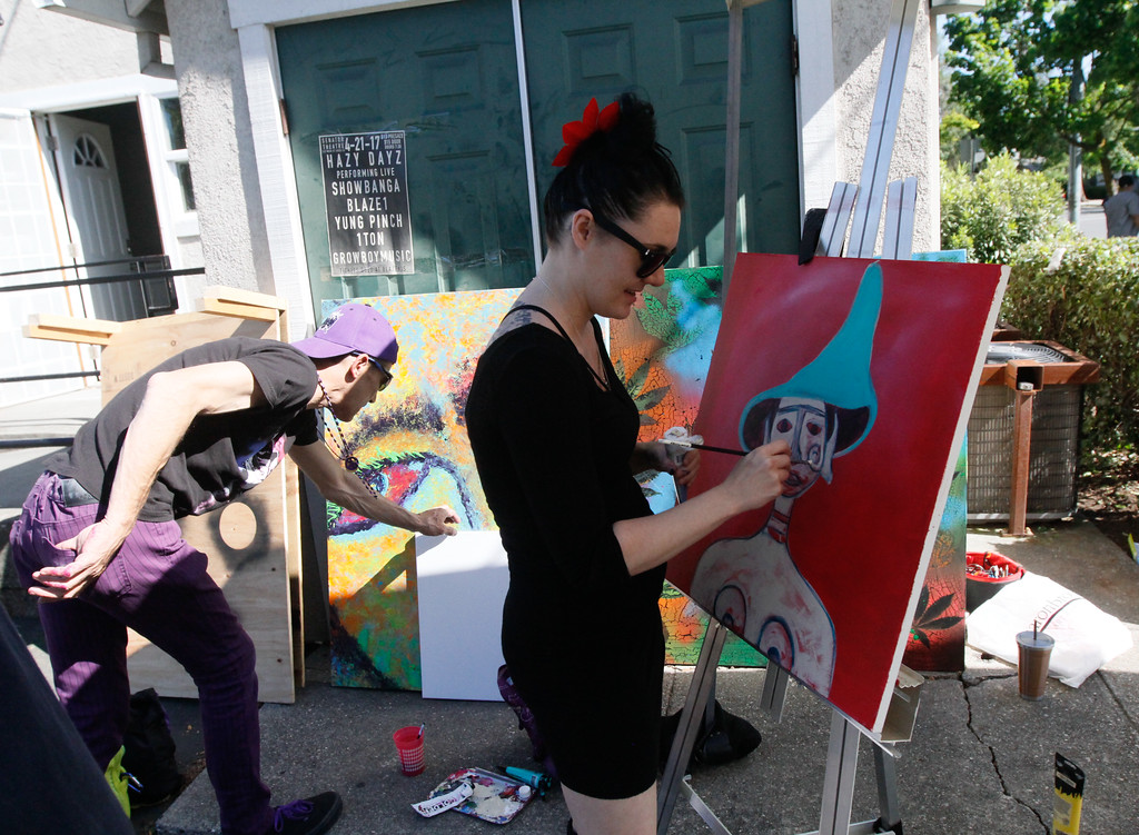 . Shardae Stogden paints as people celebrate 420 Thursday April 20, 2017 at Blaze N\' J\'s Smoke Shop in Chico, California. (Emily Bertolino -- Enterprise-Record)
