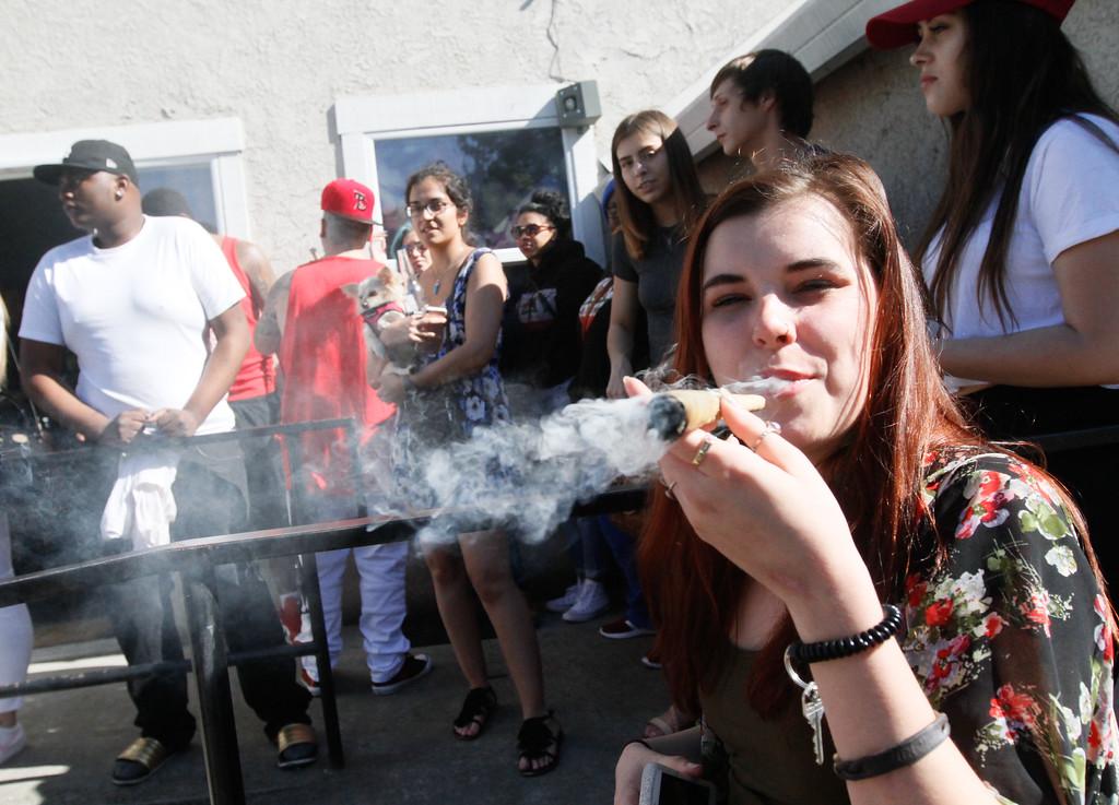 . Hunter Reitzel  celebrates 420 by smoking a huge joint Thursday April 20, 2017 at Blaze N\' J\'s Smoke Shop in Chico, California. (Emily Bertolino -- Enterprise-Record)