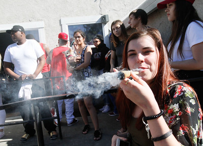 Hunter Reitzel  celebrates 420 by smoking a huge joint Thursday April 20, 2017 at Blaze N' J's Smoke Shop in Chico, California. (Emily Bertolino -- Enterprise-Record)