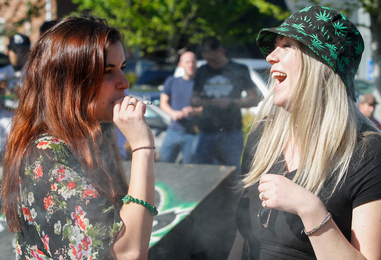 Hunter Reitzel and Courtney Schoenthaler share a joint as 4:20 p.m.  approaches at Blaze N' J's Smoke Shop Thursday April 20, 2017 in Chico, California. (Emily Bertolino -- Enterprise-Record)
