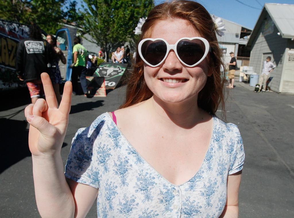 . Daisy Mendoza strikes a pose during a 420 party Thursday April 20, 2017 at Blaze N\' J\'s Smoke Shop in Chico, California. (Emily Bertolino -- Enterprise-Record)