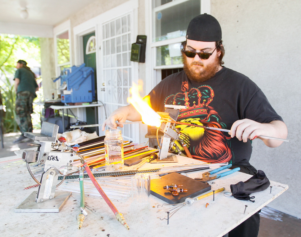 . Glass artist Jeremiah Wallicer works on a piece Thursday April 20, 2017 at Blaze N\' J\'s Smoke Shop in Chico, California. (Emily Bertolino -- Enterprise-Record)
