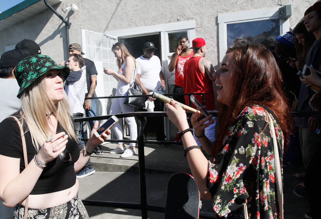 . Courtney Schoenthaler and Hunter Reitzel share a joint as 4:20 p.m.  approaches at Blaze N\' J\'s Smoke Shop Thursday April 20, 2017 in Chico, California. (Emily Bertolino -- Enterprise-Record)