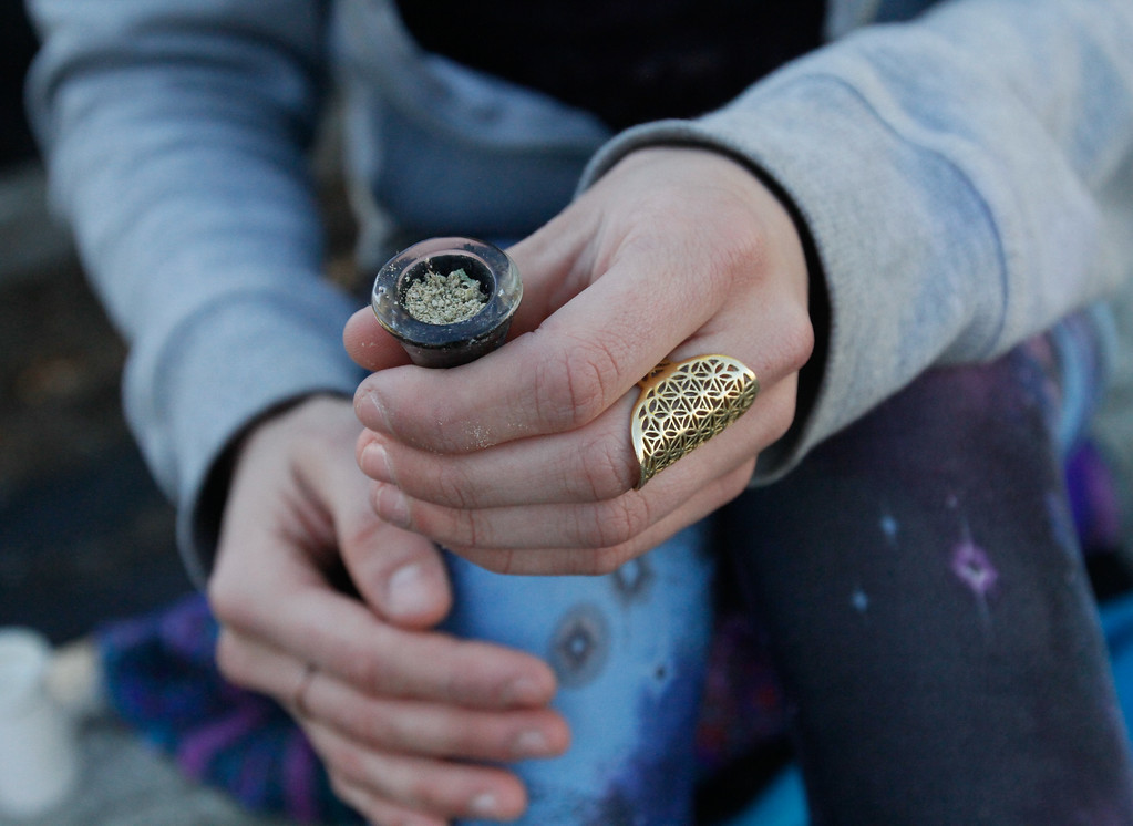 . Sequoia Oceana loads keef into a bong during a 420 party Thursday April 20, 2017 at Blaze N\' J\'s Smoke Shop in Chico, California. (Emily Bertolino -- Enterprise-Record)