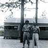 Title: Unidentified soldiers in front of black tar paper barracks. Camp Shelby, Mississippi.  <br /> <br /> Location: Camp Shelby<br /> <br /> Notes from Seiji: 1st battalion men. Wall of barrack made of black tar paper. Charcoal stove at two ends of barrack to keep warm.<br /> <br /> Photo courtesy of Seiji Oshiro. Copyright retained by the Estate of Seiji Oshiro.