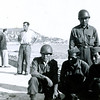 """Title: Weekend pass. 1st row, l-r: """"Donald Duck"""" Konichika, Tatsuo Oshiro, Nakamoto. 2nd row: Sakuma. Nice, France.<br /> <br /> Inscription: Washington DC - 1943 <br /> (NOTE: Date and Location are incorrect)<br /> <br /> Date: 1944<br /> :<br /> Location: Nice, France<br /> <br /> Notes from Seiji: Not in Washington DC. Nakamoto - stepped on mine in attack on Bruyeres. Oshiro was right behind Nakamoto. Mine exploded 6 feet in air with shrapnel. Mine was a dud & only smoke came out. Rained day before, then snowed, so affected mine. """"The rain saved my life."""" Walking thru mine field single file.  Seiji Oshiro's nickname was """"Stud"""".  All the girls liked Seiji. Masato Doi gave Seiji his nickname.<br /> <br /> Photo courtesy of Seiji Oshiro. Copyright retained by the Estate of Seiji Oshiro."""