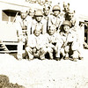 """Title: 1st Battalion. Group Photo. 2nd row, 4th from left: Fujiki. 3rd row, l-r: Not Known, Seiji Oshiro, Sgt. """"Blackie"""" Takeuchi. Camp Shelby, Mississippi.<br /> <br /> Location: Camp Shelby<br /> <br /> Notes from Seiji: 1st battalion. Barracks. Called it chicken coop. It was cold & dusty. No grass.<br /> <br /> Photo courtesy of Seiji Oshiro. Copyright retained by the Estate of Seiji Oshiro."""