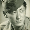 """Title: """"Nish"""" Nishimura. Studio Portrait<br /> <br /> Inscription: Just """"Nish""""<br /> <br /> Date: 1944-1945<br /> <br /> Location: Nice, France<br /> <br /> Notes from Seiji: Nishimura from Spokane. Pup tent buddy.  He take care of me.  Kotonk. Survived war. Nickname """"Nish"""".  Good buddy. Shared pup tent. Seiji used to cook for whole squad.  Made mulligan stew in 5 gal square can.  Can got holes from artillery, so couldn't cook with it.  Squad got mad. Seiji was cooking so didn't have time to dig foxhole. Fell on another soldier  in his foxhole and covered him for half hour.  Learned lesson to dig foxhole first.<br /> <br /> Photo courtesy of Seiji Oshiro. Copyright retained by the Estate of Seiji Oshiro."""