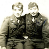 Title: Seiji Oshiro and Unidentified Soldier. Antitank Company, 442nd RCT.<br /> <br /> Inscription: Unable to Determine<br /> <br /> Location: France<br /> <br /> Notes from Seiji: Glider patch on cap. Photo taken after Operation Dragoon.<br /> <br /> Photo courtesy of Seiji Oshiro. Copyright retained by the Estate of Seiji Oshiro.