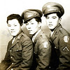 """Title: Training Buddies, l-r: """"Hot Sauce,"""" Yano, Oshiro. Camp Shelby, Mississippi<br /> <br /> Date: 1943<br /> <br /> Location: Camp Shelby Mississippi<br /> <br /> People: Hot Sauce, Yano, Seiji Oshiro<br /> Notes from Seiji:Shipped out as anti-tank (was formerly 1st Battalion). Hot Sauce & Oshiro shipped out as antitank. Liberty ships took 28 days. Landed in Naples, Italy. Then sent to Anzio. Stayed for 1 week. Then went to front line. Then Rome for a break. Then merged at Civitavecchia with 100th. Yano stayed in 1st Battalion.<br /> <br /> Photo courtesy of Seiji Oshiro. Copyright retained by the Estate of Seiji Oshiro."""
