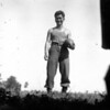 Title: Seichi Tamanaha holding football.  Fox company. P.O.W. Camp.<br /> <br /> Date: 1945.05.xx to 1945.07.xx<br /> <br /> Location: Ghedi Airfiield, Italy<br /> <br /> Notes from Yasunori: This was the first POW camp that the Battalion worked at. USO group came over.  The star performer was Jinks Falkenburg; actress & singer. Lake Cuomo resort near here.  Near Swiss border.  Stayed here May & June 1945.  In late July, moved south to Leghorn, Italy.  For similar assignment, guarding POW's.<br /> <br /> Photo courtesy of Yasunori Deguchi. Copyright retained by the Estate of Yasunori Deguchi.