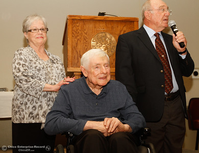 Steve Nettleton, center, gets induced into the Chico Sports Hall of Fame with the support of his wife Kathy and words from Don Batie at the 44th Chico Sports Hall of Fame and Senior Athletes' Banquet May 10, 2016 at the Elks Lodge in Chico, Calif. (Emily Bertolino -- Enterprise-Record)