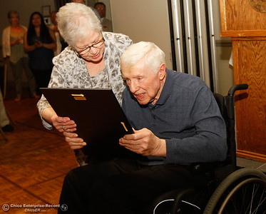 Steve Nettleton and his wife Kathy look at his plaque at the 44th Chico Sports Hall of Fame and Senior Athletes' Banquet May 10, 2016 at the Elks Lodge in Chico, Calif. (Emily Bertolino -- Enterprise-Record)
