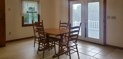 Dining area with access to deck