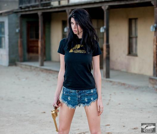 Nikon D800E Photos Cowgirl Model Goddess with Cutoff Daisy Dukes Blue Jeans Cowboy Boots & Gold 45 Revolver Gun!