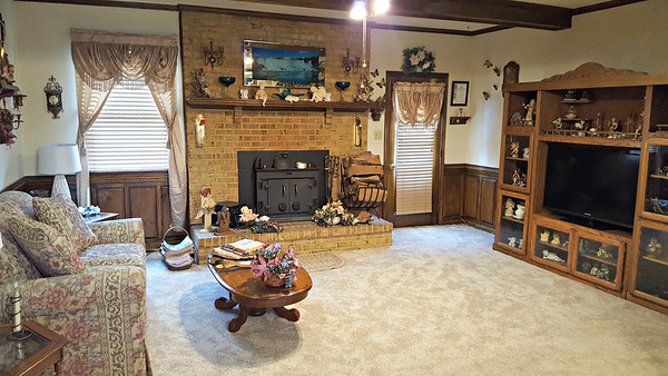 Family room with brick fireplace