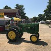 A patron rides his John Deere at the 47th annual Antique Power and Steam Exhibition in Burton, Ohio July 30. (Harley Marsh/The News-Herald)