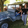 Snapchat correspondents Kailee Leonard (in the vehicle) and Harley Marsh pose with a WWII jeep at the 47th annual Antique Power and Steam Exhibition in Burton, Ohio July 30. (Taken for News-Herald)
