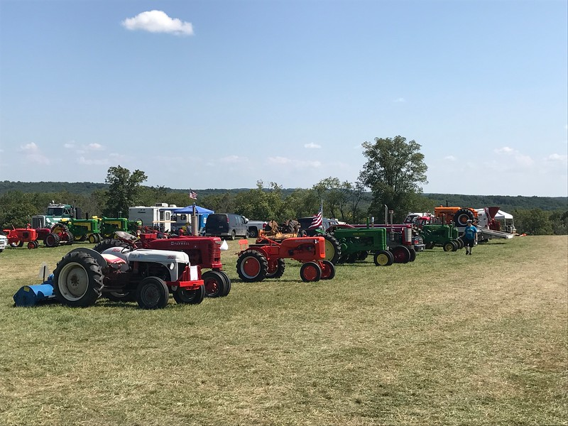 Tractors are lined up on display at the 47th annual Antique Power and Steam Exhibition in Burton, Ohio July 30. (Harley Marsh/The News-Herald)