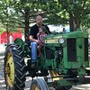 Patrons take a John Deere tractor for a spin during the 47th annual Antique Power and Steam Exhibition in Burton, Ohio July 30. (Harley Marsh/The News-Herald)