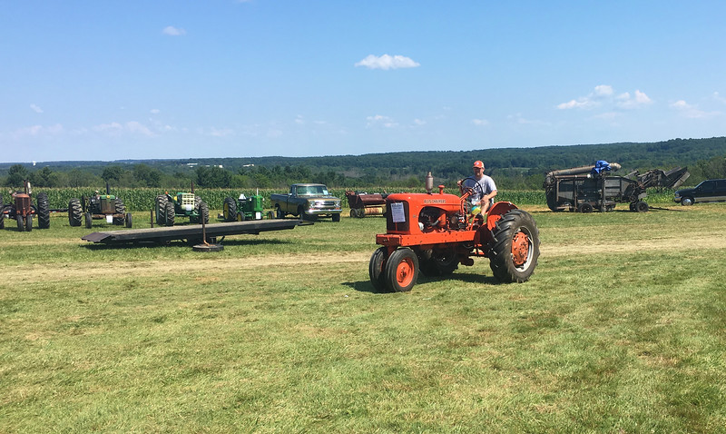 An event attendee rides a round his tractor at the 47th annual Antique Power and Steam Exhibition in Burton, Ohio July 30. (Kailee Leonard/The News-Herald)