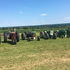 Tractors are lined up in front of a corn field at the 47th annual Antique Power and Steam Exhibition in Burton, Ohio July 30. (Kailee Leonard/The News-Herald)