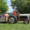 Patrons ride around the museum during the 47th annual Antique Power and Steam Exhibition in Burton, Ohio July 30. (Harley Marsh/The News-Herald)