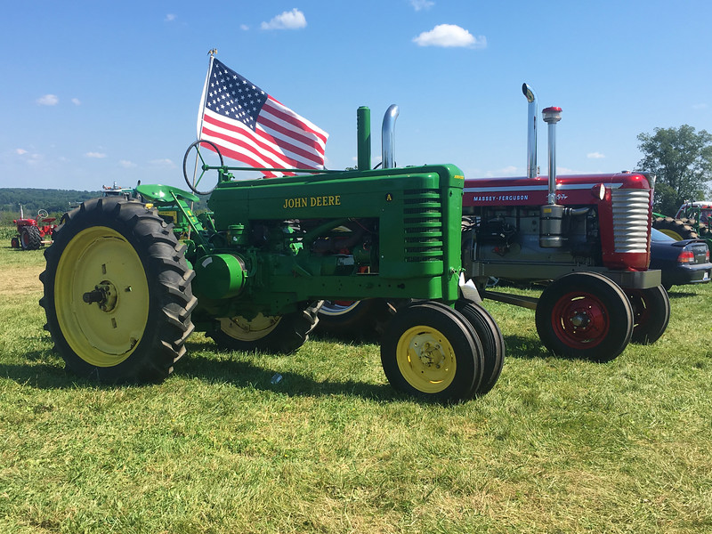 Tractors are lined up on display at the 47th annual Antique Power and Steam Exhibition in Burton, Ohio July 30. (Kailee Leonard/The News-Herald)