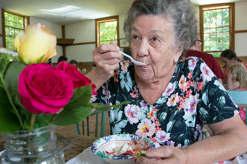 The 47th annual Tyngsboro-Dunstable Historical Society Strawberry Festival was held at the Sarah Tyng Little Red School House in Dunstable on Saturday, June 22, 2019. Enjoying some of the strawberry shortcake at the festival is Joan Croteau of Groton. SENTINEL & ENTERPRISE/JOHN LOVE