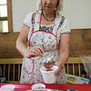 The 47th annual Tyngsboro-Dunstable Historical Society Strawberry Festival was held at the Sarah Tyng Little Red School House in Dunstable on Saturday, June 22, 2019. Vice President of the Historical Society Anne Fenochetti scoops some strawberries for some strawberry shortcake during the festival. SENTINEL & ENTERPRISE/JOHN LOVE