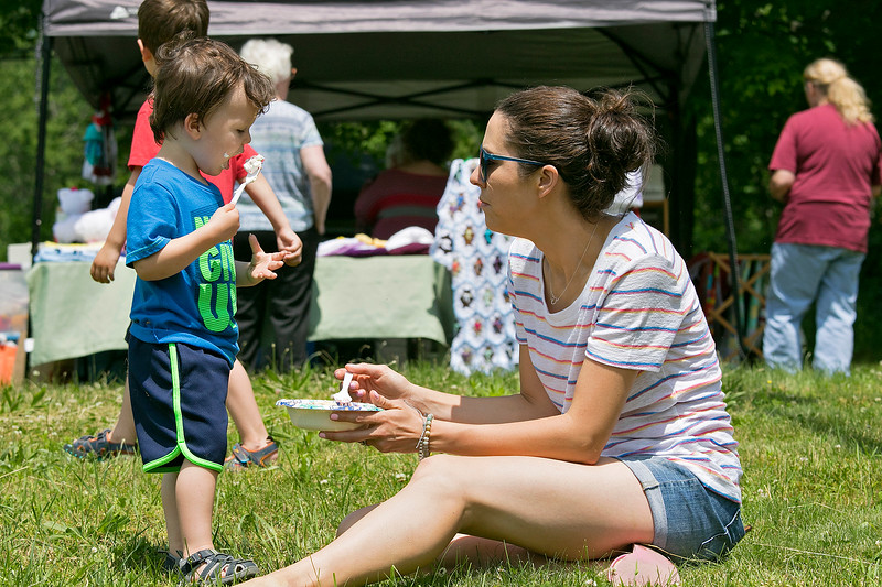 The 47th annual Tyngsboro-Dunstable Historical Society Strawberry Festival was held at the Sarah Tyng Little Red School House in Dunstable on Saturday, June 22, 2019. Lindsay Farrington shares her strawberry shortcake with her son Gavin, 2, both of Groton during the festival. SENTINEL & ENTERPRISE/JOHN LOVE