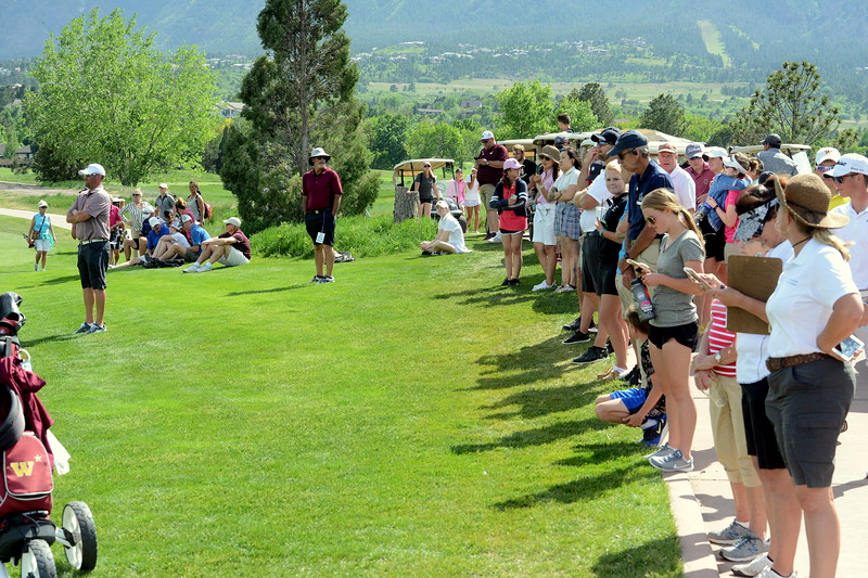 A full gallery gathered to watch the top group play No. 18 during Tuesday's second round of the 4A state girls golf tournament at Country Club of  Colorado in Colorado Springs. (Mike Brohard/Loveland Reporter-Herald)