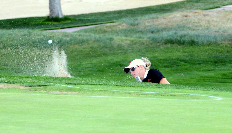 Loveland's Lauren Lehigh chips onto the green from a bunker during Tuesday's second round of the 4A state girls golf tournament at Country Club of  Colorado in Colorado Springs. (Mike Brohard/Loveland Reporter-Herald)
