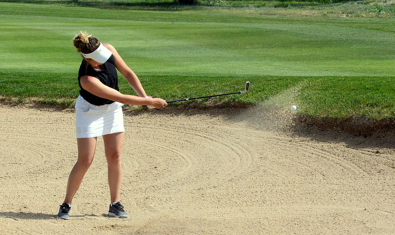 Mountain View's Camryn Polansky chips out of a green-side bunker during  the second round of the 4A state girls golf tournament at Country Club of  Colorado in Colorado Springs. (Mike Brohard/Loveland Reporter-Herald)