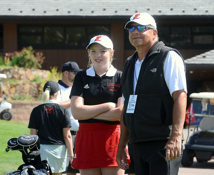 Loveland's Taylor Bandemer waits for her tee time with coach Bill Stephens during Tuesday's second round of the 4A state girls golf tournament at Country Club of  Colorado in Colorado Springs. (Mike Brohard/Loveland Reporter-Herald)