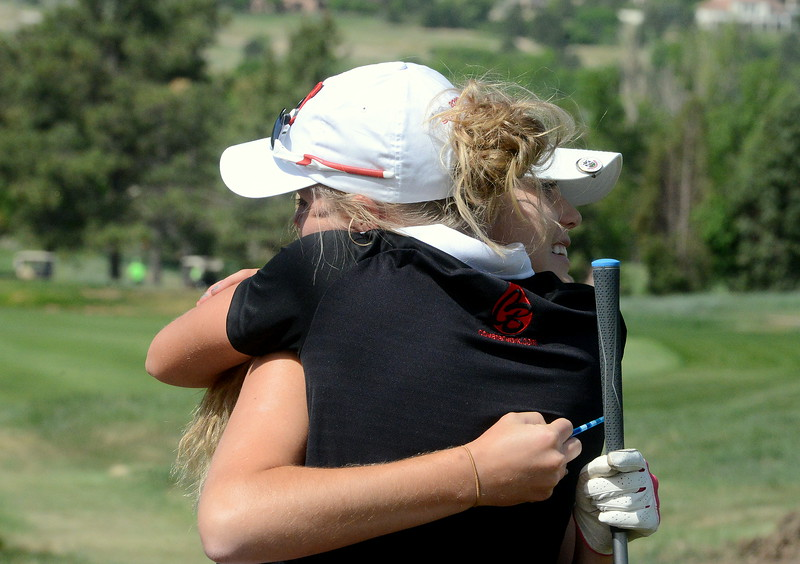 Loveland's Lauren Lehigh gives Mountain View's Renee Demaree a hug before Demaree tees off on No. 1 during Tuesday's second round of the 4A state girls golf tournament at Country Club of  Colorado in Colorado Springs. (Mike Brohard/Loveland Reporter-Herald)