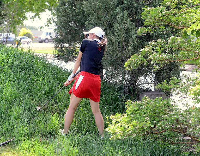 Loveland's Casey Bradley chips out of the tall grass on No. 12 during  Tuesday's second round of the 4A state girls golf tournament at Country Club of  Colorado in Colorado Springs. (Mike Brohard/Loveland Reporter-Herald)