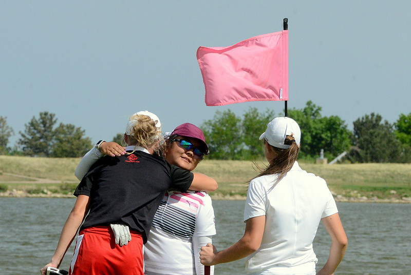 Loveland's Lauren Lehigh (left) hugs Maxine Choi of Cheyenne Mountain as Windsor's Jessica Zapf comes in to offer congratulations on Choi's 4A state golf title Tuesday at the Country Club of Colorado in Colorado Springs. Choi birdied the final hole for the win. (Mike Brohard/Loveland Reporter-Herald)