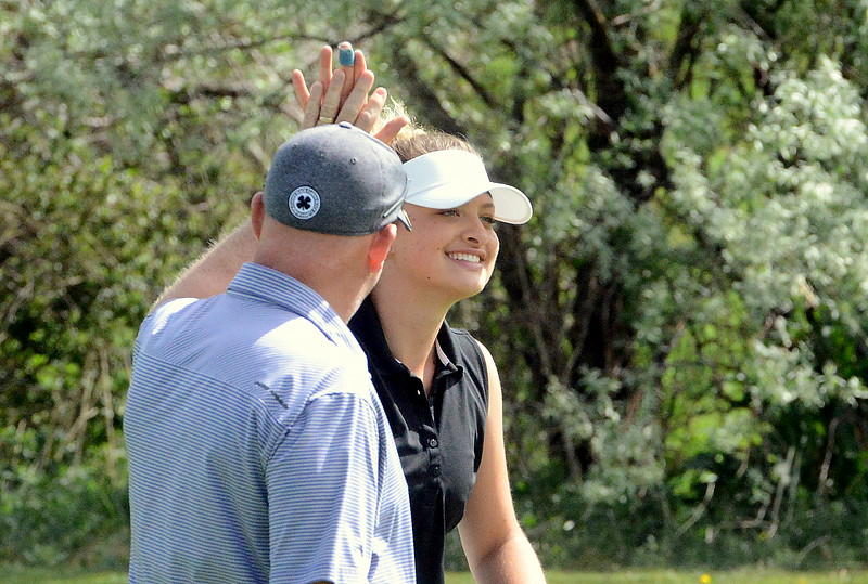 Camryn Polansky gets a high five from Mountain View coach Dave Hunn after a good shot during  the second round of the 4A state girls golf tournament at Country Club of  Colorado in Colorado Springs. (Mike Brohard/Loveland Reporter-Herald)